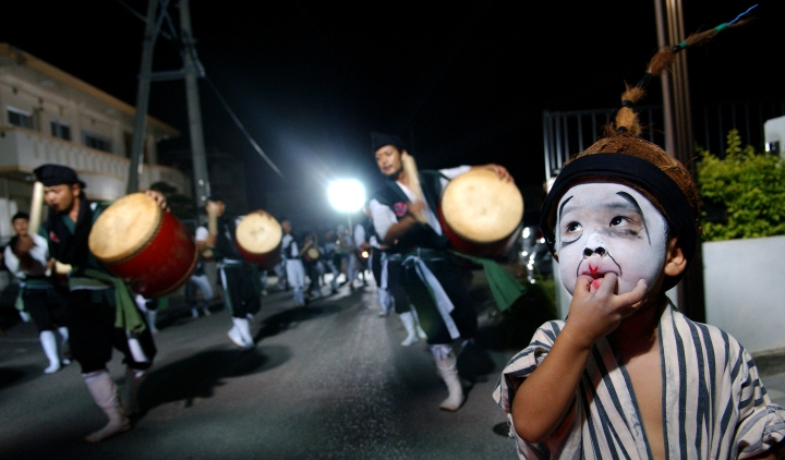 "A young Okinawan child participates in an Obon dance or ""Eisa.""  Throughout Obon, there will be Eisa dancers and family celebration late into the evening. (U.S. Air Force photo/Tech. Sgt. Rey Ramon)"